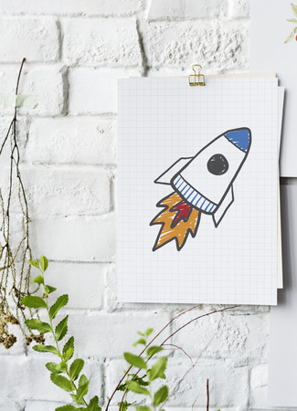 Rocket launch drawing on a paper poster on white wall Banque d'images - 110597815