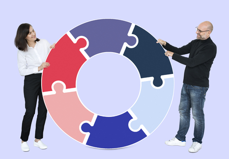 Man and woman with a chart Stock Photo