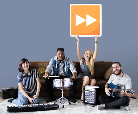 Band of musicians holding a fast forward button icon Stock Photo