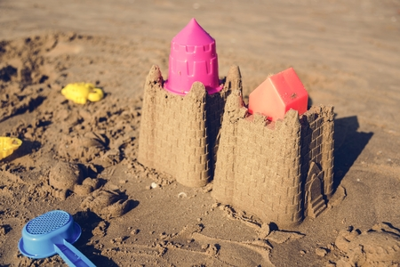 Cute sand castle on the beach Stock fotó