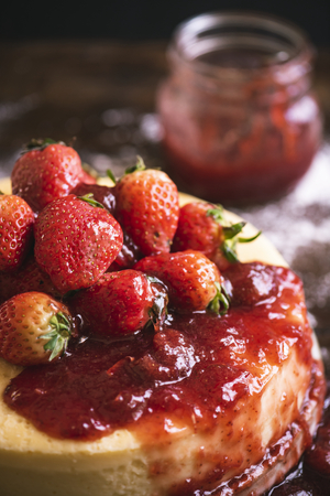 Cheesecake topped with strawberry sauce