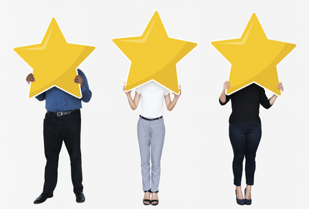Diverse businesspeople showing a golden star rating symbol