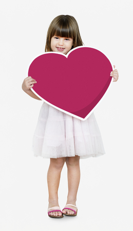 Happy girl holding a heart icon Archivio Fotografico