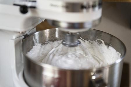 Stand mixer mixing baking ingredients Фото со стока