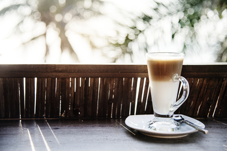 A glass of latte by the beach Stockfoto - 110598556
