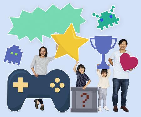 Happy family holding gaming icons Stockfoto