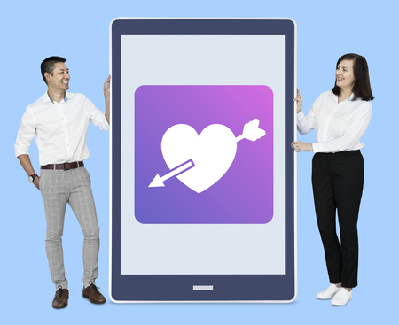 Man and woman with digital love concept Stock Photo