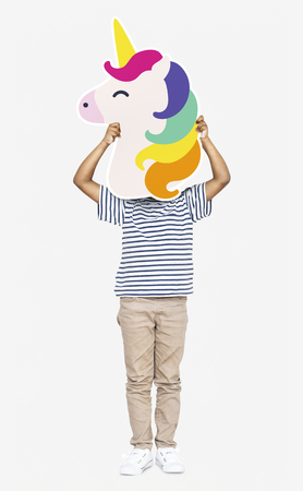 Little boy holding a unicorn icon Stock fotó