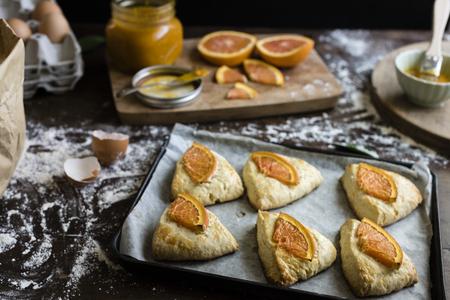 Homemade scones with orange jam food photography recipe idea Stok Fotoğraf