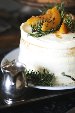 Sliced apricots on top of a white cake