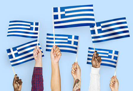 Hands waving flags of Greece Stock Photo