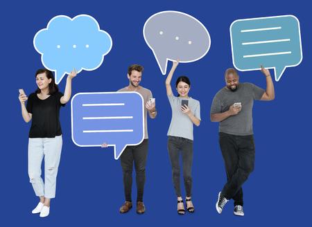 Diverse social media people holding speech bubble symbols Stock Photo