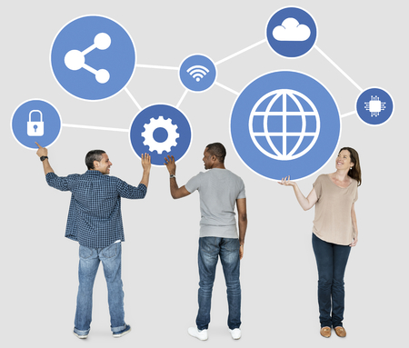 Diverse people holding blue networking icons Stockfoto