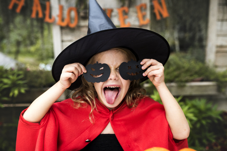 Young playful girl enjoying Halloween