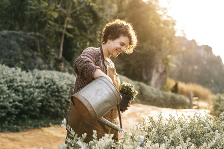 Woman taking care of the flowers at her countryside home