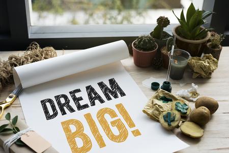 Dream big written on a white paper and cactus Фото со стока