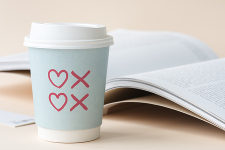 Hearts and kisses symbols drawn on a paper cup Stock Photo