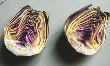 Fresh hearts of artichoke on the table