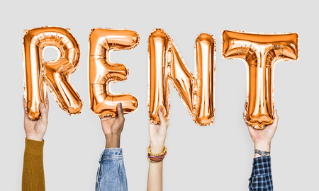 Orange alphabet balloons forming the word rent Standard-Bild - 110600011