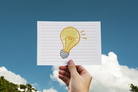 Light bulb drawn on a paper 스톡 콘텐츠