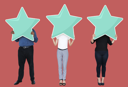 Diverse businesspeople showing a star rating symbol Stock Photo