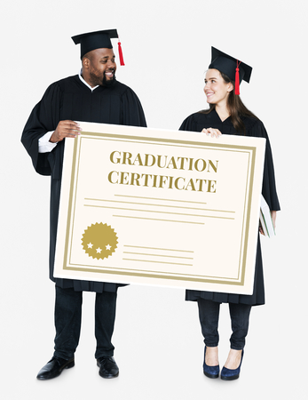 Female and male grad holding a graduation certificate Stock Photo