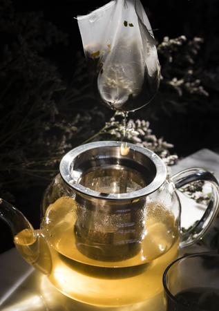 Herbal tea in a glass teapot