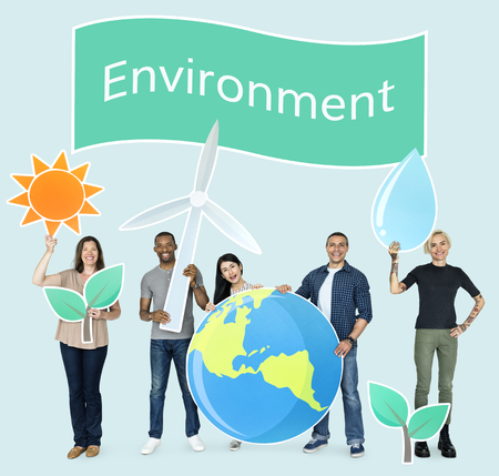 Group of diverse people holding eco-friendly icons Foto de archivo - 110600400