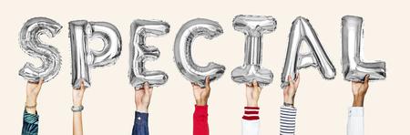 Silver gray alphabet balloons forming the word special Banco de Imagens