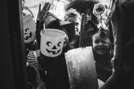 Little children trick or treating on Halloween Stock fotó
