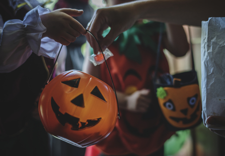 Little children trick or treating on Halloween Stock Photo