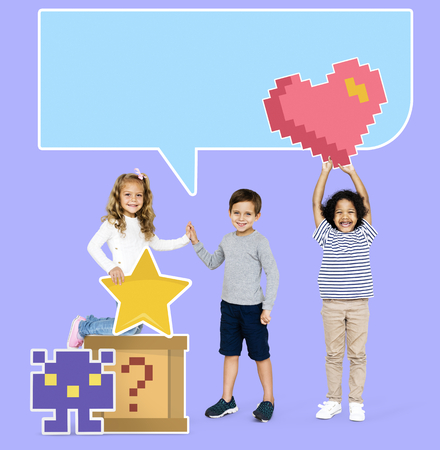 Happy diverse kids with pixilated gaming icons Stock Photo