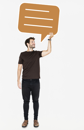 Cheerful man holding a blank speech bubble symbol