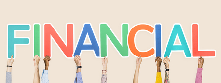 Hands holding up colorful letters forming the word financial