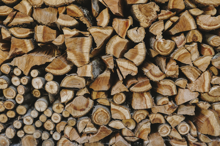Stack of firewood textured background