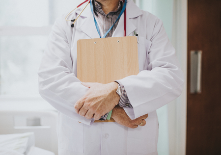 Physician holding a clipboard with medical information