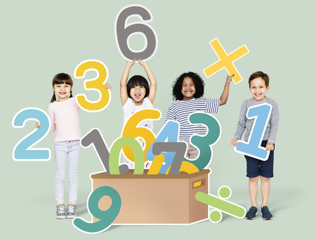 School kids learning mathematics with numbers