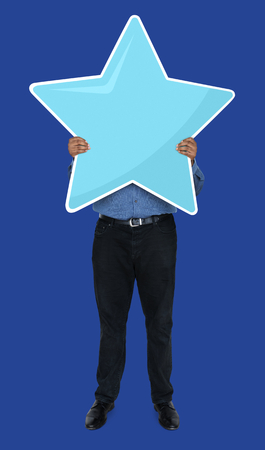 Businessman showing a star rating symbol Stock Photo