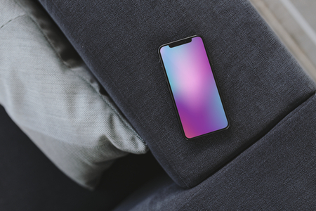 Mobile phone with a colorful background Stock Photo