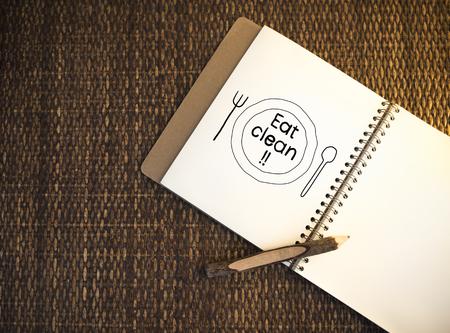 Eat clean written on a notebook