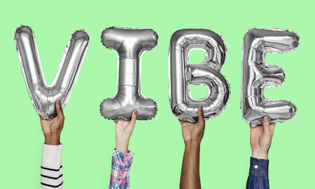 Gray silver alphabet balloons forming the word vibe