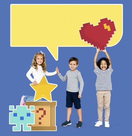 Happy diverse kids with pixilated gaming icons Stok Fotoğraf