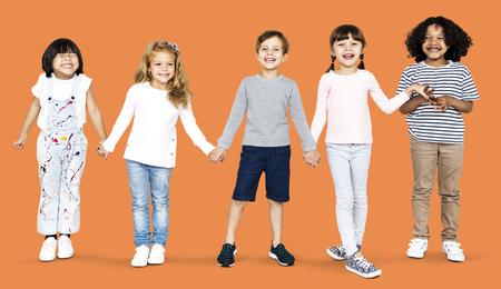 Cheerful kids holding hands 版權商用圖片