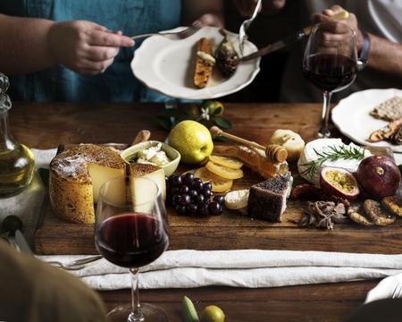 People enjoying a cheese platter food photography recipe idea