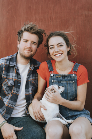 Couple with their adopted Chihuahua dog