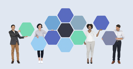 Business people with connected hexagon boards