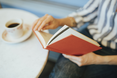 Closeup of a woman reading a book