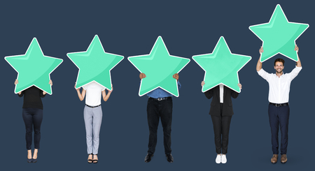 Diverse businesspeople showing star rating symbols
