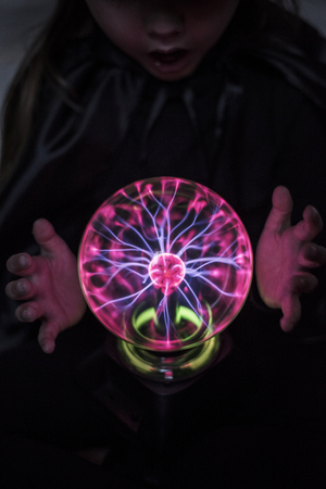 Little fortune teller with a plasma ball Imagens