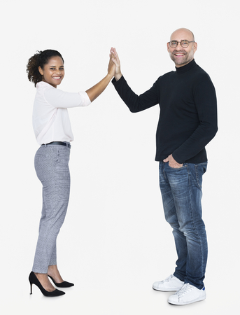 Business partners doing a high five